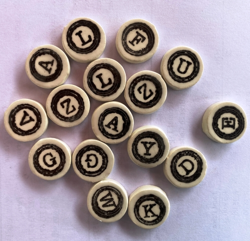1009--black-on-white-letters-of-alphabet--round